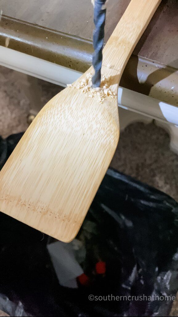 drilling a hole in wooden spatula