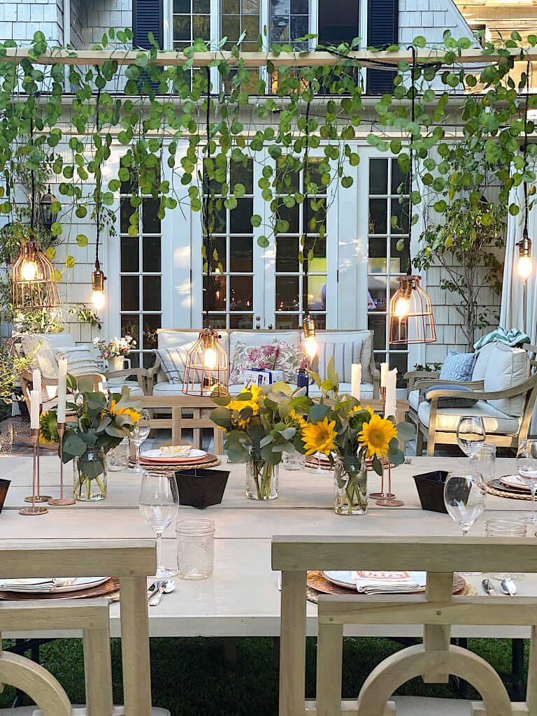 outdoor dining with sunflowers