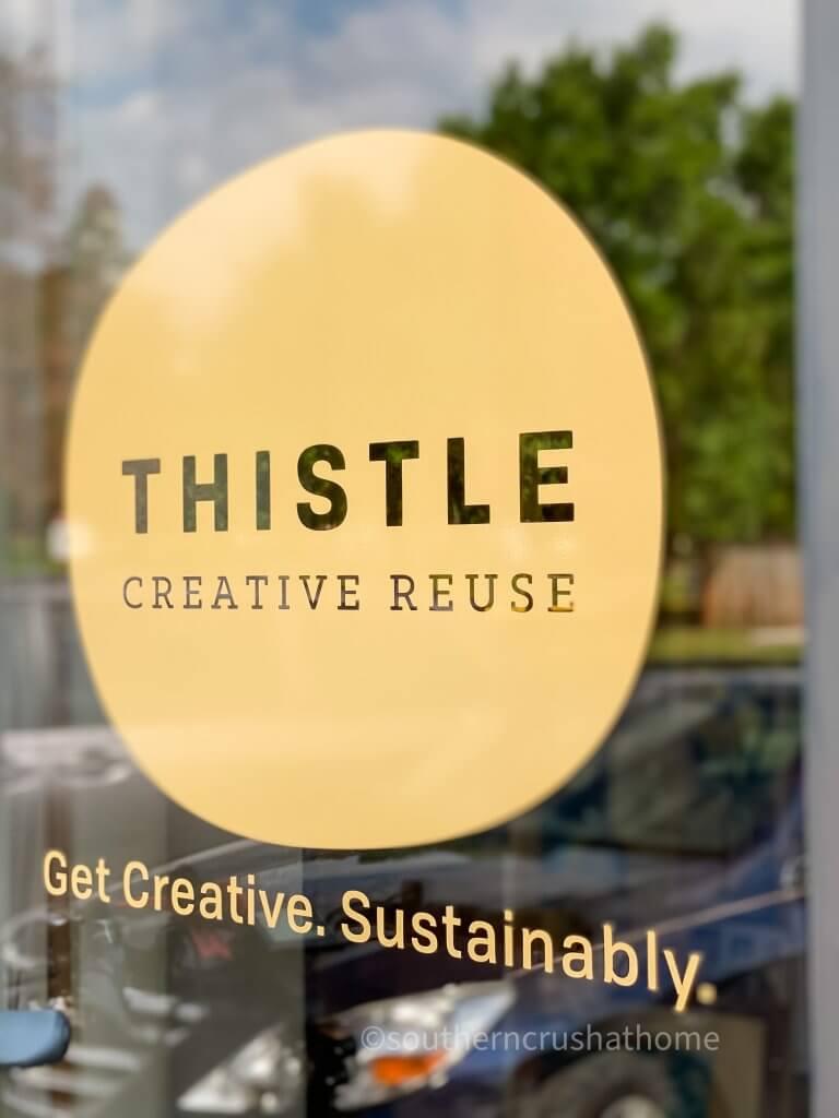 Thistle Creative Reuse front door logo