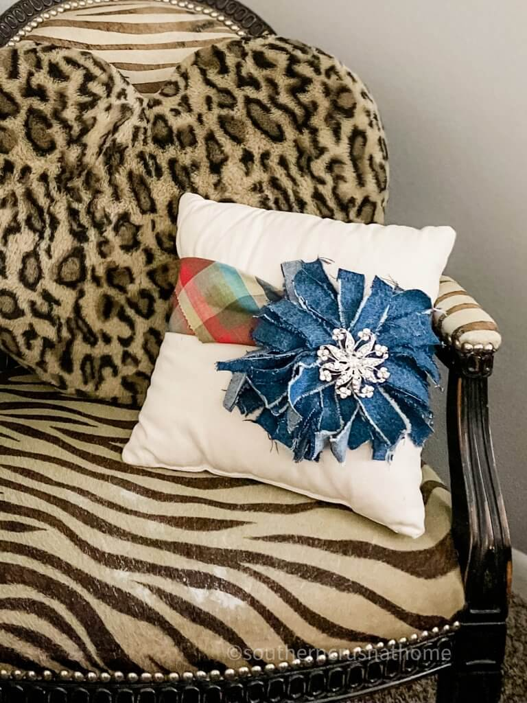 denim messy bow on pillow on chair