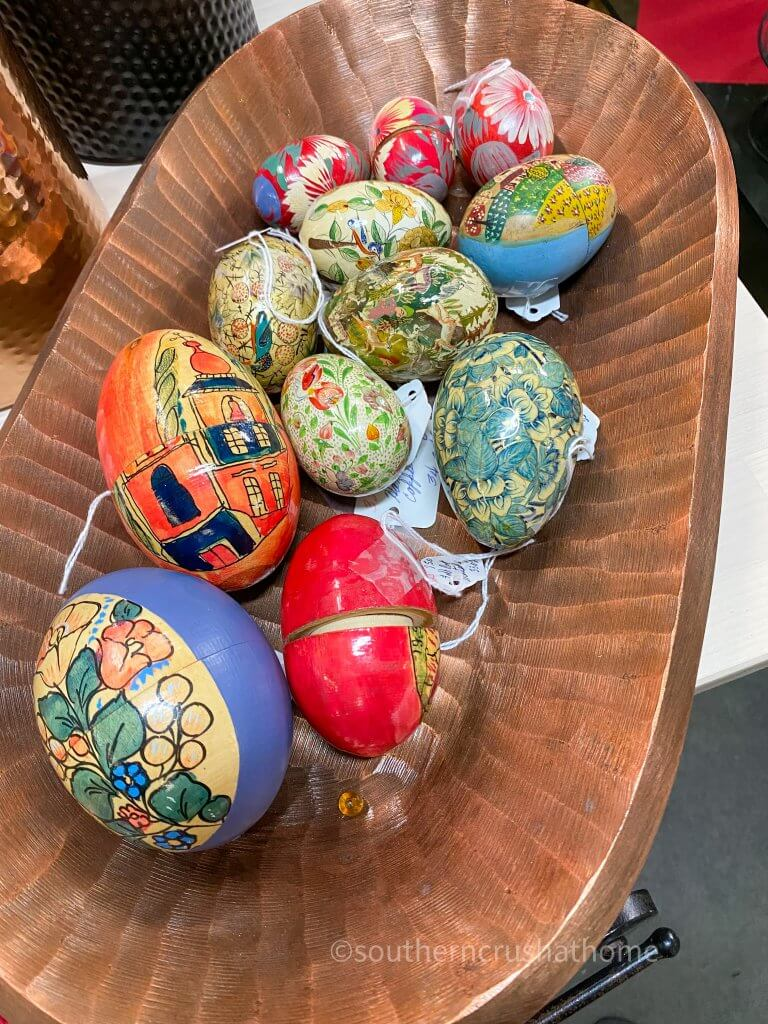 colorful wooden eggs in wooden dough bowl display