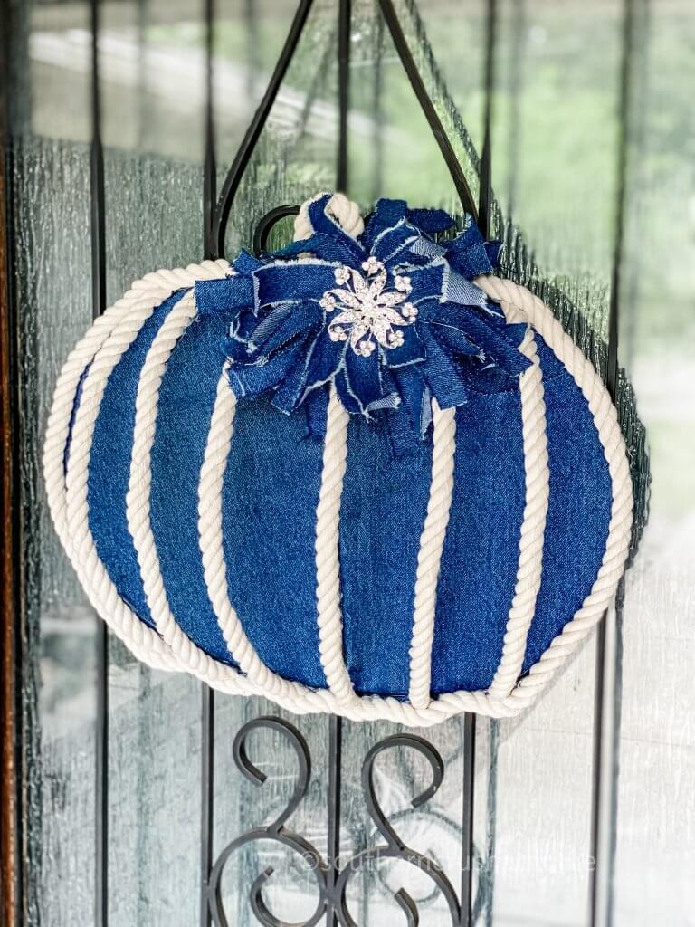 pumpkin wreath door decor hanging on front door