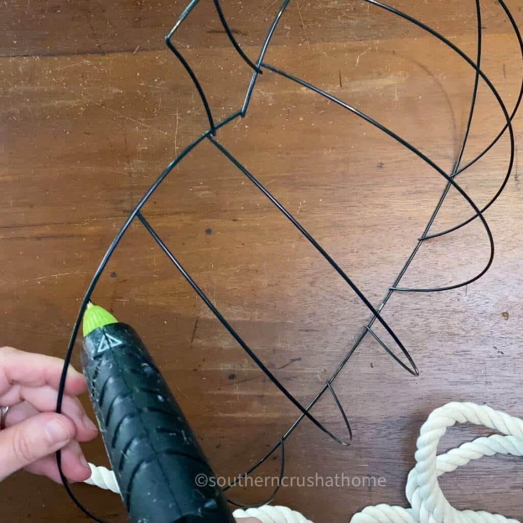 add hot glue to pumpkin wreath form