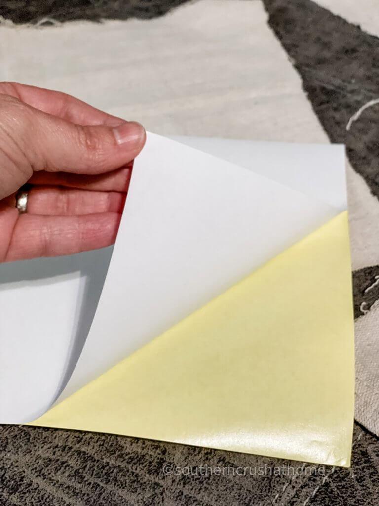 sticker paper peeling back