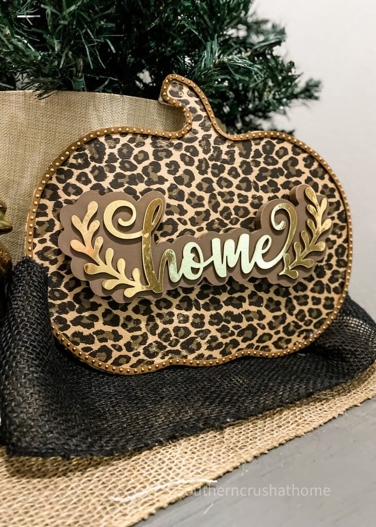 leopard foil pumpkin decor with home sign on table