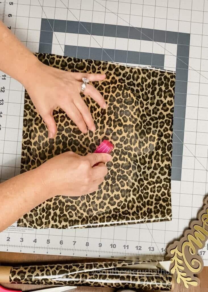 using nail buffer to burnish foil