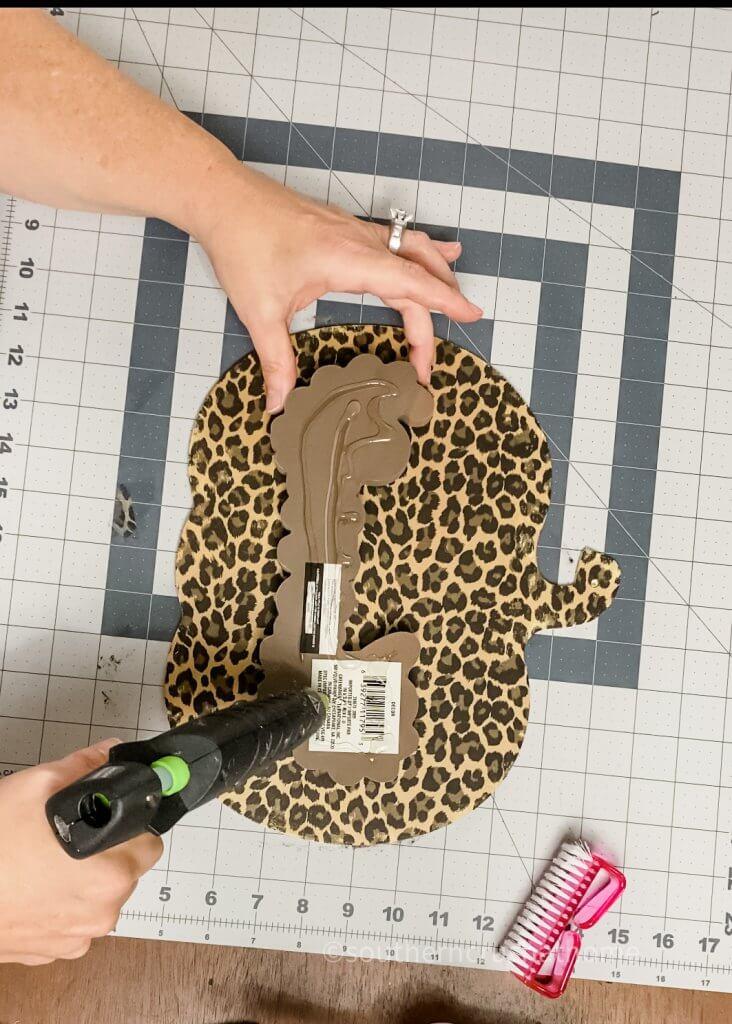using hot glue gun to secure applique