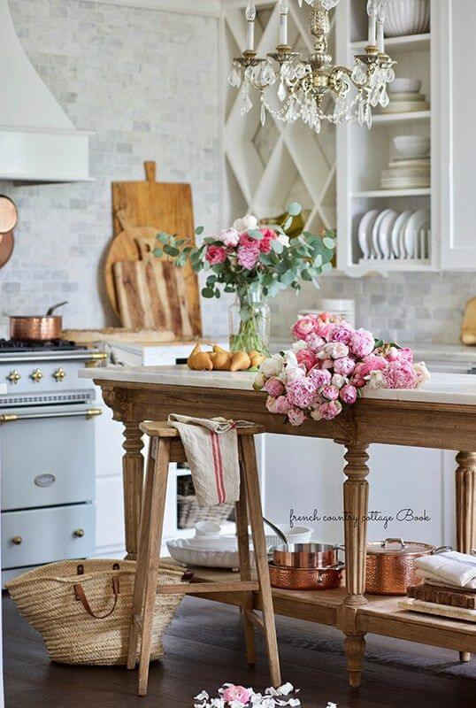 kitchen view with flowers and cutting boards