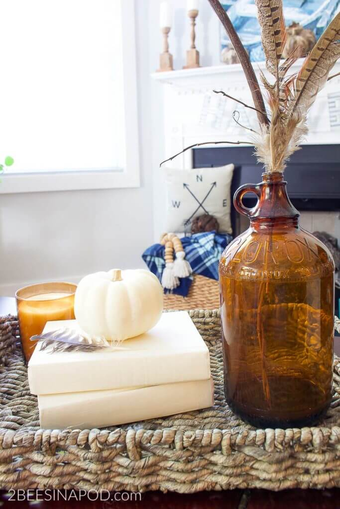 amber glass, feathers and white pumpkin