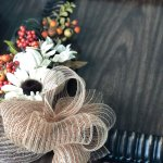 mesh ribbon attached to fall frame with fall flowers