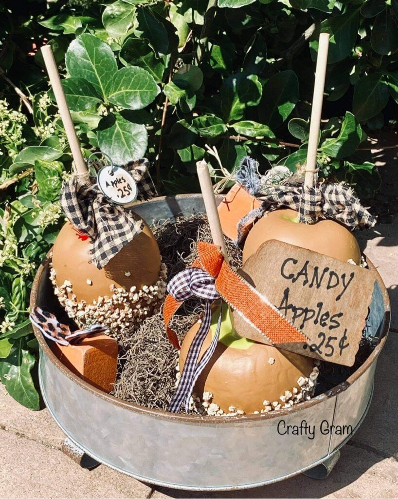 faux candy apples in bucket display