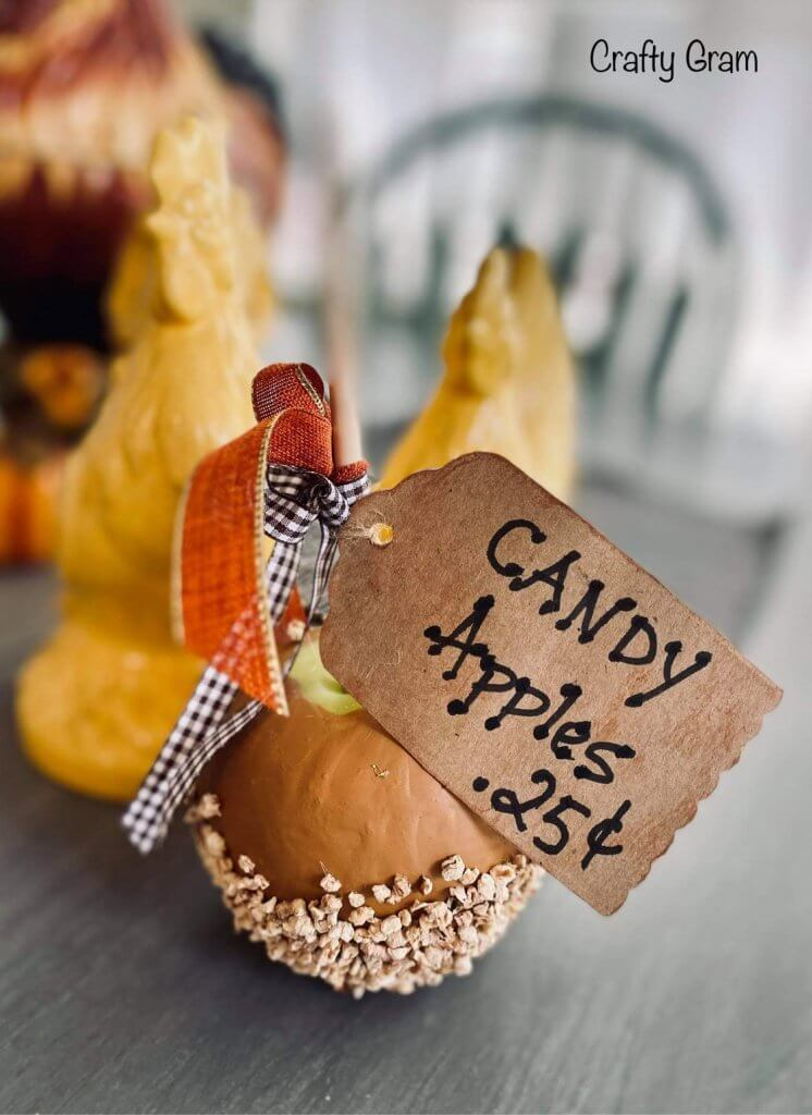 single faux candy apple with tag