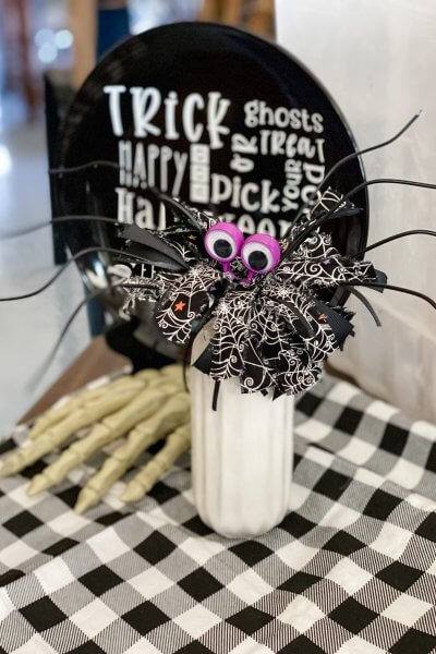 whisk spider on table