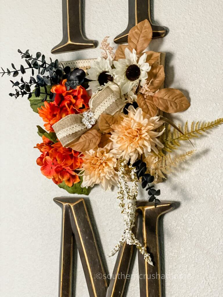 close up of fall foliage on home sign