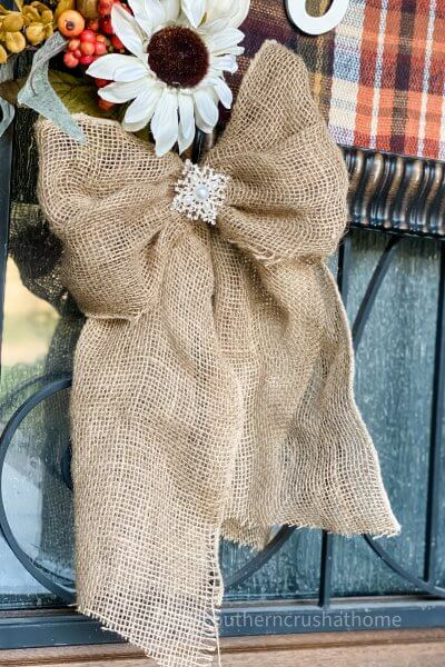 burlap bow hanging from fall sign