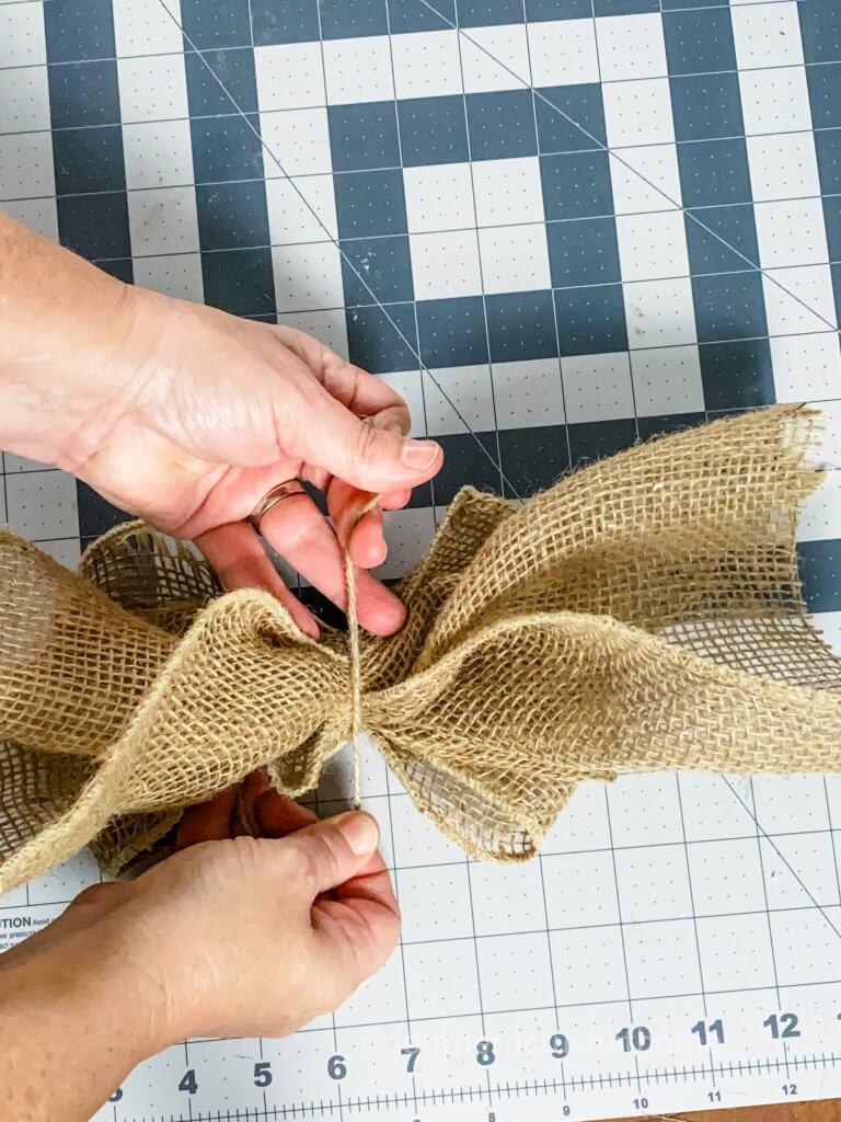 tying twine to burlap bow