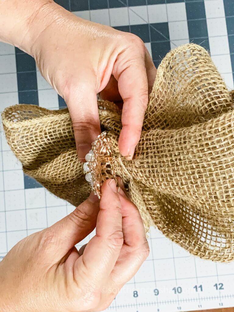 securing rhinestone embellishment to burlap bow