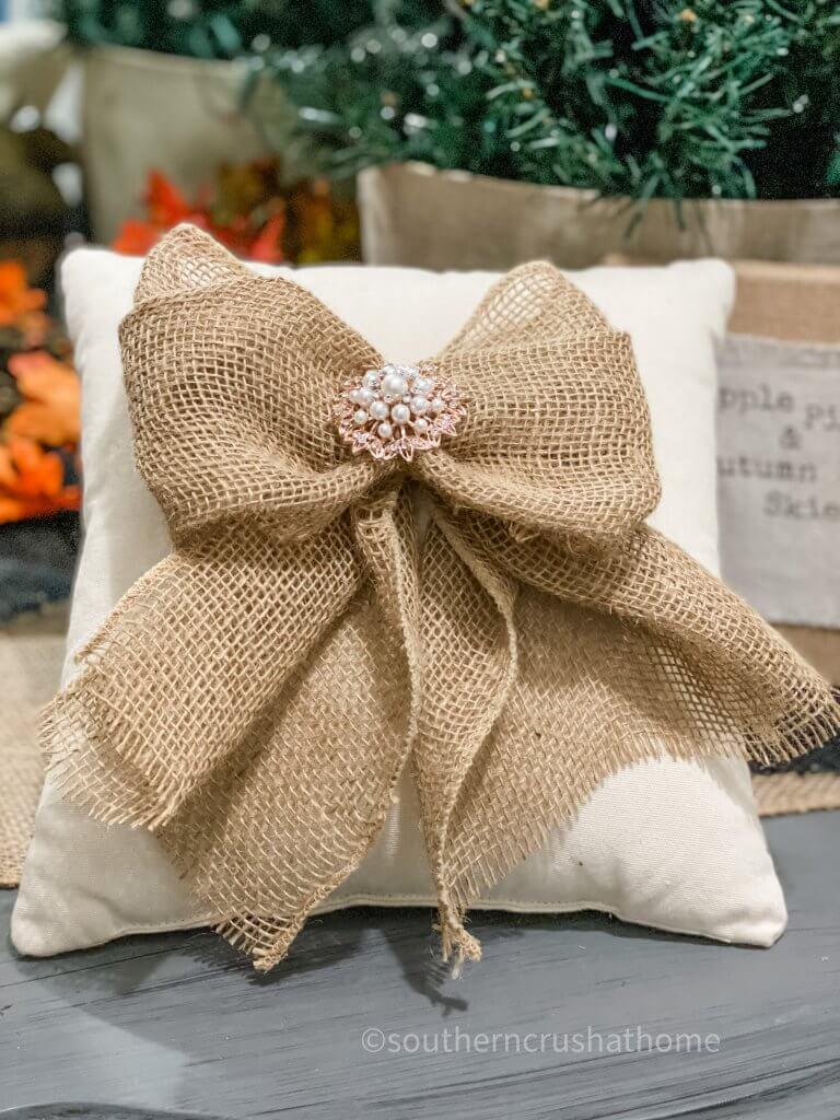 burlap bow shown on pillow