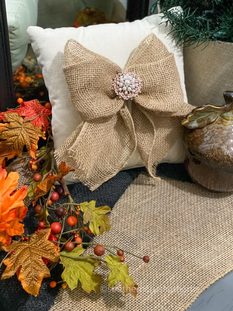 easy burlap bow shown on pillow