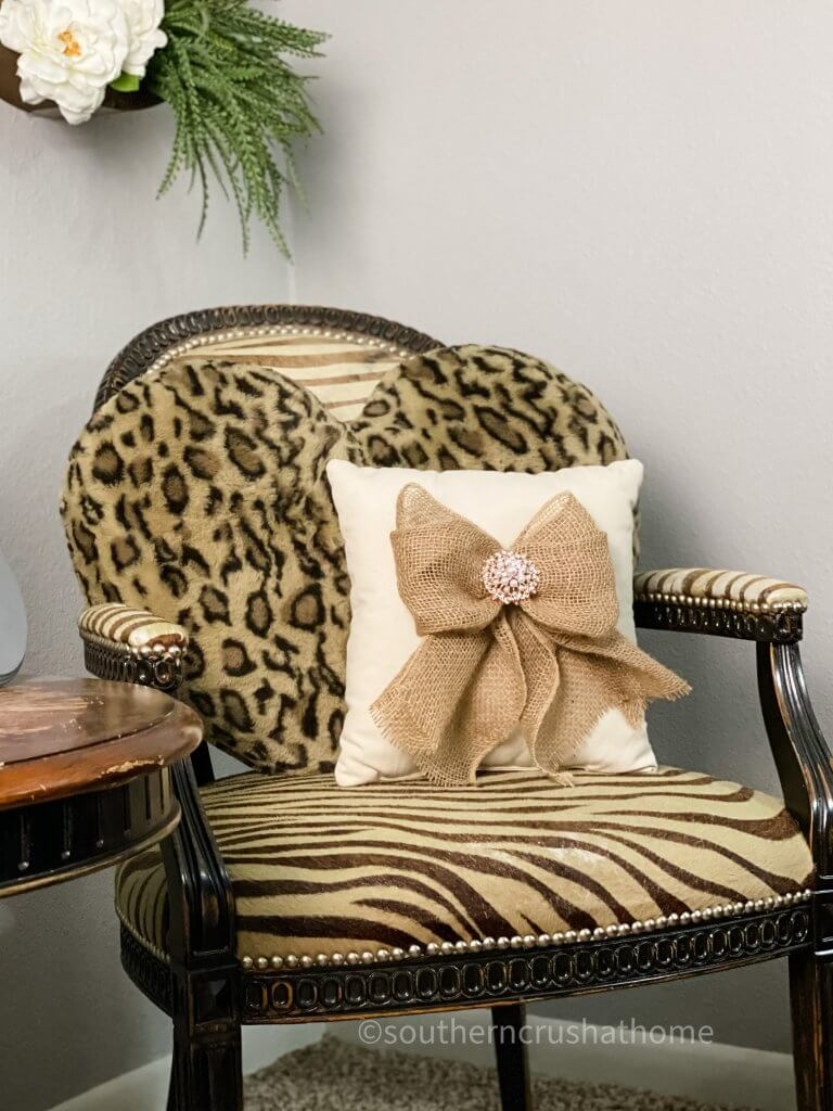 burlap bow on pillow on chair