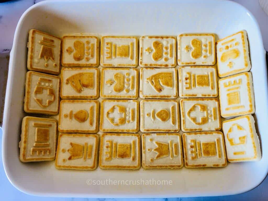 placing cheesecake cookies in pan