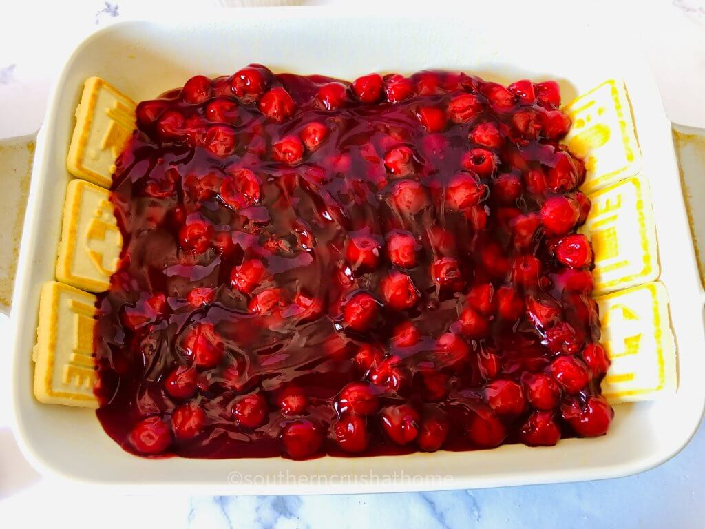 adding cherries to pan