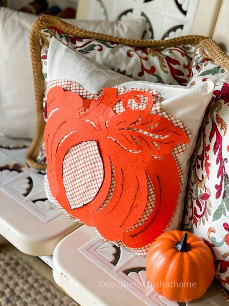 pumpkin pillow on bench