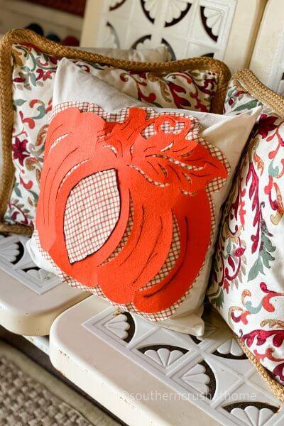 dt pumpkin pillow on bench
